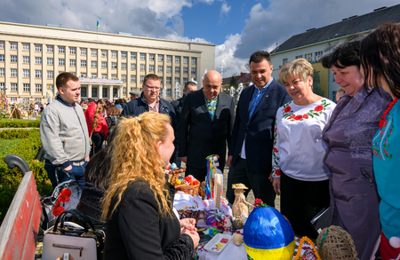 Uzhgorod, Ukraine - April 07, 2017: Celebrating Orthodox Easter in Uzhgorod on the Narodna square. Hennadiy Moskal, the governor of TransCarpathian region, take a conversation with participants Stock Photo - 98811205