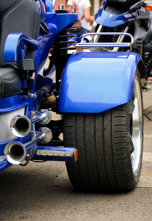 rear side of a blue motorcycle. lovely detail shot of lights and shiny exhaust pipes Foto de archivo