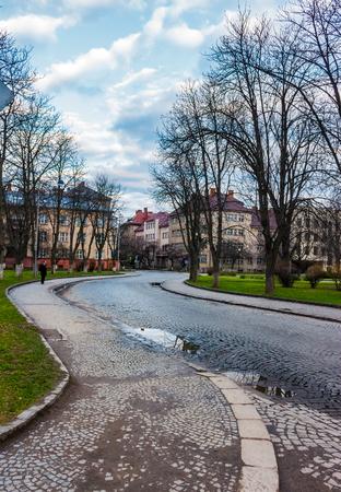 cobble street winding through old town. lovely cityscape in springtime. location Narodna square, Uzhgorod, Ukraine. 写真素材