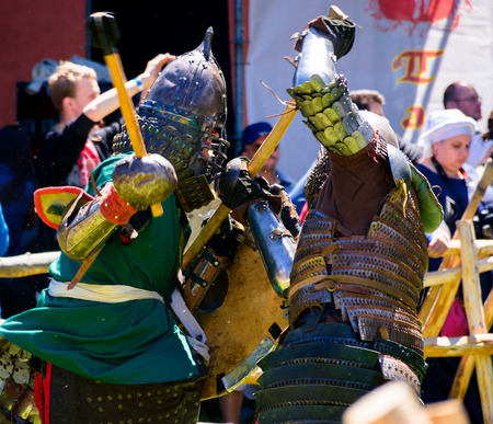 Chynadiyovo, Ukraine - May 27, 2017: medieval culture festival Silver Tatosh. Location St. Miklos Castle. Knight participants show their skills in fighting
