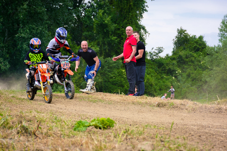 Uzhgorod, Ukraine - May 21, 2017: Extreme enduro MOTO SPORT Junior riders in the action. Parents show their support. TransCarpathian regional Motocross Championship Editorial