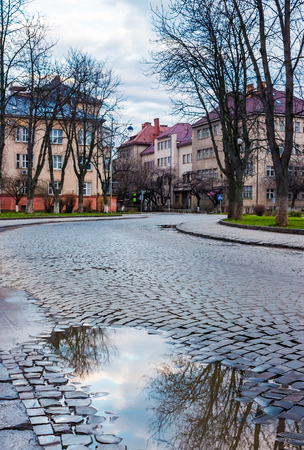 cobble street winding through old town. lovely cityscape in springtime. location Narodna square, Uzhgorod, Ukraine. Banco de Imagens