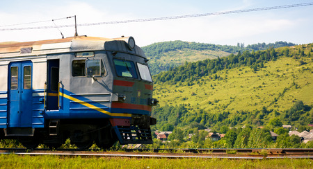 Huklyvyi, Ukraine - 20 Jul, 2017: ancient electric train arrival. moving fast in mountains Editorial