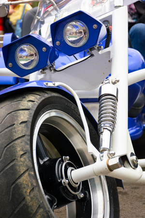 close up details of blue trike with chrome parts