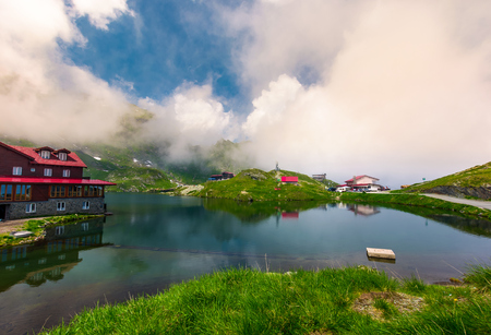 area of lake Balea in clouds. Gorgeous summer landscape of Fagarasan mountains, Romania. popular tourist location