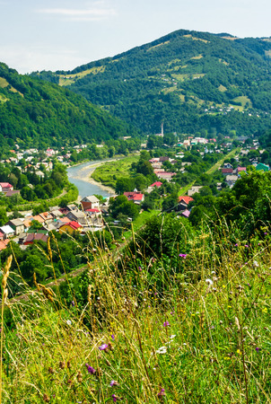 Rakhiv town in summer view from the hill. beautiful scenery in Carpathian mountains. Tisza river winds through the valley Stock Photo