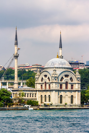ISTANBUL, TURKEY - AUGUST 18, 2015: Ortakoy Mosque infront of the cityscape, view from the other side of Bosphorus in Istanbul Editorial