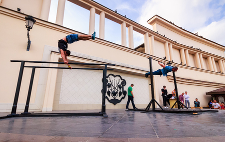 Uzhgorod, Ukraine - Jun 10, 2016: participants of outdoor sports competition. workout championship in Uzhgorod. Young men show their skill on the arena