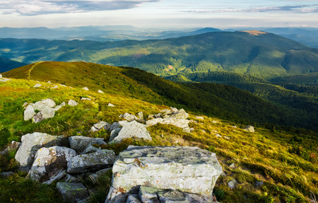 beautiful view of Carpathians in dappled light. wonderful colors of summer landscape in mountains on a cloudy day observed from the top of a hill. location Runa mountain, Ukraine Stock Photo - 99265313