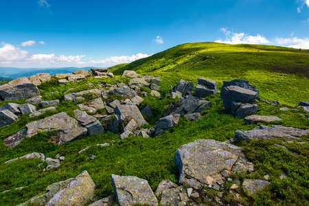 huge rocky formation on the grassy hillside. beautiful landscape of Runa mountain on a bright summer day Stock Photo