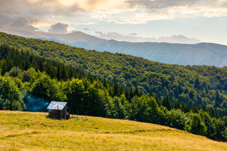 pasture and shed on the hillside. lovely summer landscape of Carpatian mountain Editorial