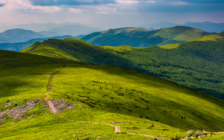 path through grassy meadow on hillside. beautiful summer landscape of great Carpathian water dividing ridge. Location TransCarpathia, Ukraine Stock Photo