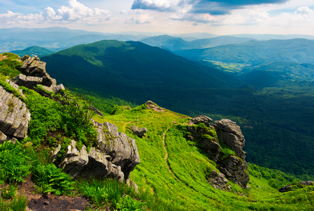 path to a tiger face cliff above the valley. spectacular landscape of Carpathian mountains in summertime. location Pikui mountain, Ukraine Stock Photo