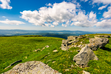 huge boulders on the edge of hillside. fine weather in summer mountain landscape Stock Photo - 100348162