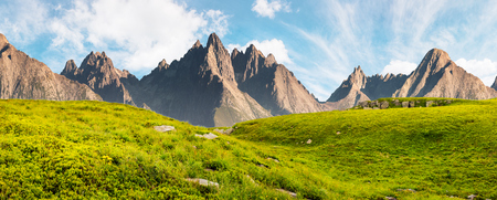 Hight Tatra mountain summer landscape composite image. grassy meadow with stones on top of the hillside near the peak of mountain range Stock Photo