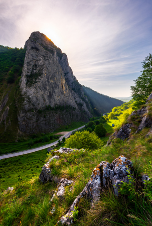 road in Canyon of Trascau mountains in the morning. lovely scenery of Carpathian landscape in springtime. beautiful travel destination. location Cheile Valisoarei, Romania Stock Photo
