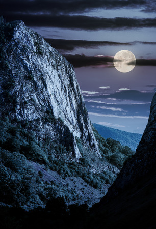 cliffs of Trascau mountains canyon at night in full moon light. lovely scenery of Carpathian landscape in springtime. beautiful travel destination. location Cheile Valisoarei, Romania Stock Photo