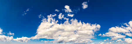 gorgeous cloudscape panorama on a blue summer sky. beautiful weather background with dynamic cloud arrangement