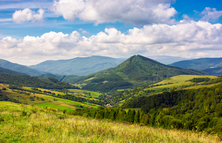 Abranka village in the valley of Carpathian mountains, Ukraine. lovely countryside scenery in early autumn with clouds distant ridge. Stock Photo