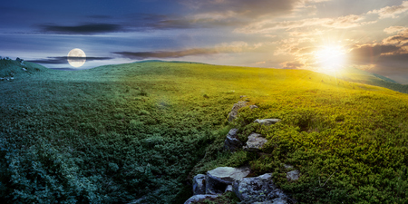 time change concept with sun and moon over panoramic landscape. lovely summer scenery with boulders among the grass. location Runa mountain, Ukraine Banco de Imagens - 101904133