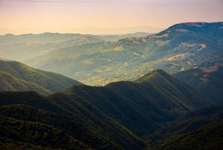 beautiful rolling hills of Carpathian mountains. lovely summer landscape, bird eye view. village Brustury down in the valley, TransCarpathia, Ukraine