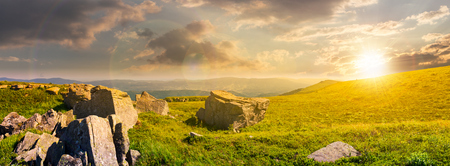 beautiful panorama of Runa mountain at sunset. huge rocky formation on the hillside and peak in the distance. wonderful landscape of Carpathians