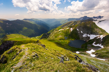 beautiful landscape of Romanian mountains. lovely summer scenery on a cloudy day. Lake Capra down the hillside Stock Photo