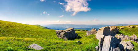 beautiful panorama of Runa mountain in summer. huge rocky formation on the hillside and peak in the distance. wonderful landscape of Carpathians Stock Photo