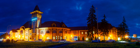 Uzhgorod, Ukraine - SEP 28, 2008: Panorama of beautiful railway station building at night Editorial