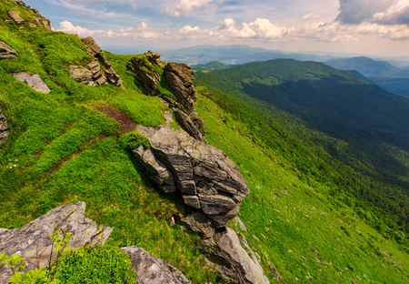 rocky cliffs of the Pikui mountain. Borzhava mountain ridge in the far distance. Beautiful summer landscape on a cloudy day Stock Photo - 102885914