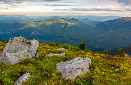 boulders on the edge of hillside. lovely view from Runa mountain, Ukraine. cloudy morning