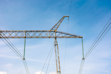 power lines tower against the blue sky. lovely energy industry background. efficient electricity delivery concept. Stock Photo