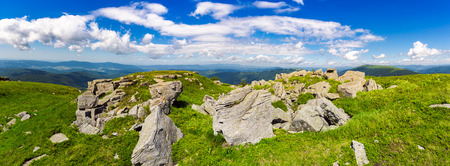 rocks of Runa mountain. panoramic view. wonderful cloudscape on a blue sky over the distant mountain range. breathtaking view of mountainous summer landscape in Carpathians Stock Photo