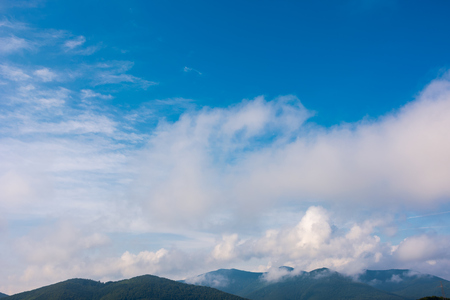 Beautiful clouds cape over the mountains. lovely nature background Stock Photo