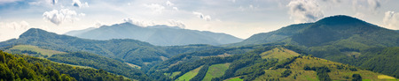 panorama of beautiful Carpathian mountains. perfect countryside landscape. rural field on the nearest forested hills. Mighty Borzhava ridge in the distance Stock Photo
