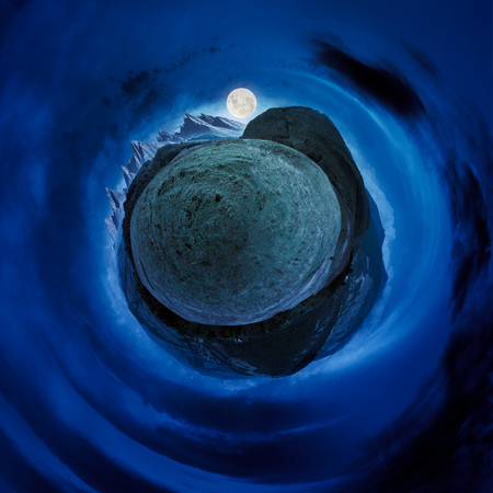 little mountain planet night spherical panorama. lovely countryside concept with 360 degree view. agricultural field on hillside and village in the valley. beautiful sky with fluffy clouds Stock Photo