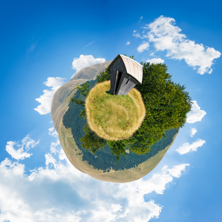 woodshed on little planet spherical panorama. beautiful countryside concept with 360 degree view. abandoned building on a meadow among the forest in summer mountains