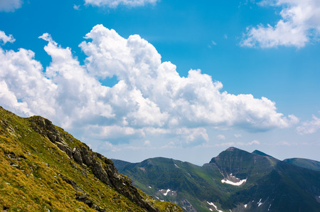 beautiful cloudscape over the Fagaras mountains. Bright sunny day in Romania. beautiful nature background Stock Photo