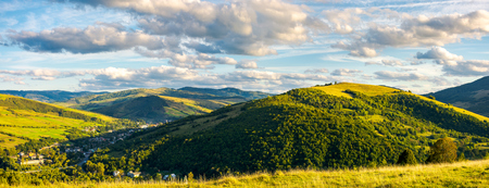 panorama of lovely mountainous area in afternoon. gorgeous cloudscpe on the evening sky. calm and peaceful living in rural area Stock Photo - 105309292