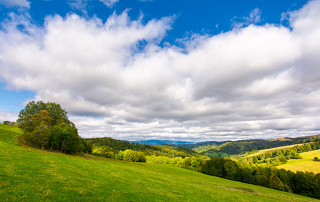beautiful cloudy sky over the forested hills. wonderful nature of Carpathians in early autumn