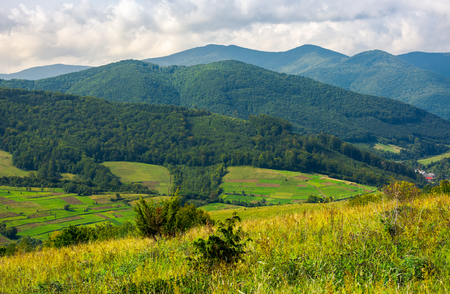 lovely rural scenery in mountains. agricultural fields on hills. beautiful landscape Stock Photo