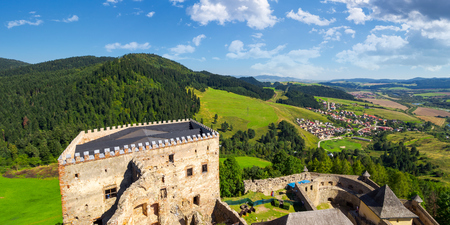 Stara Lubovna, Slovakia - AUG 28, 2016: view from the top of castle wall. beautiful rural landscape. village at the foot of the forested hill Stock Photo - 106982053