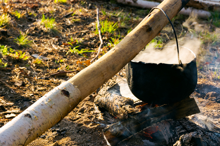cooking on the fire. camping in the wilderness. healthy food made in traditional way Stock Photo