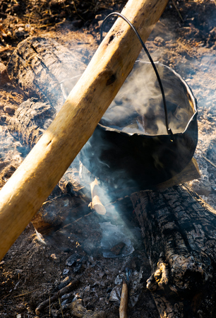 cooking in cauldron on open fire. view from above. healthy food made in natural way Stock Photo - 107011677