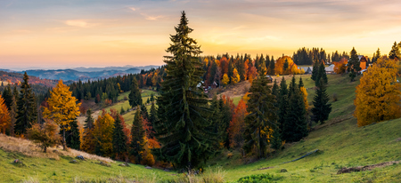 panorama of village outskirts in autumn. lovely landscape in mountains at sunset with gorgeous sky Stock Photo