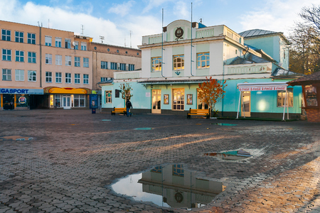 Uzhgorod, Ukraine - Nov 10, 2012: puppet theater on theatral square atfer the autumn rain at sunrise Stock Photo