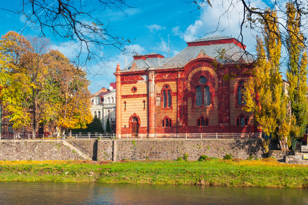 Uzhgorod, Ukraine - NOV 10, 2012: Philharmonic Orchestra Concert Hall on the bank of the river Uzh in autumn. former building of synagogue is a popular tourist attraction. beautiful sunny weather Stock Photo