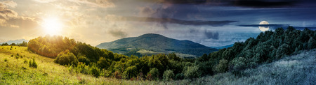 time change concept of panoramic mountainous countryside. forest on a grassy meadow. high mountain in the distance. wonderful early autumn landscape with sun and moon