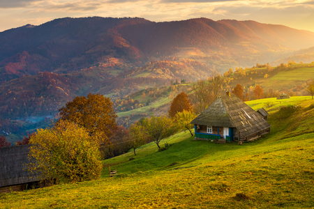 gorgeous mountainous countryside at sunrise. beautiful rural area. village on the hillside Stock Photo