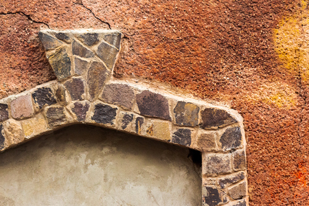 stone frame on the red wall. architectural background Stock Photo